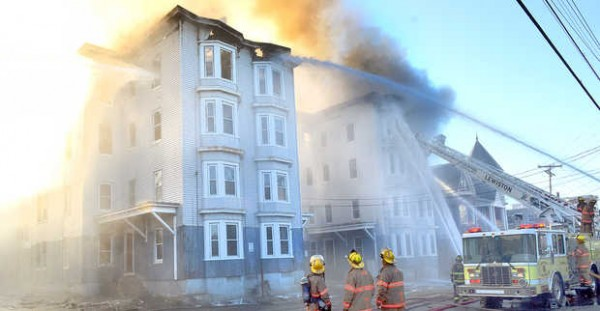 Firefighters battle the third major fire in a week at 114-118 Bartlett Street in Lewiston early Monday morning.
