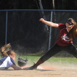 Mattanawcook Academy's Nicole Ryder (right) makes the pickoff catch as Calais's Miranda Moffett dives late to first base during the game in Lincoln Monday.