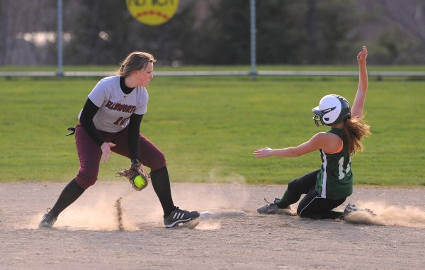 Old Town's Kelsey Heseltine (right) slides to second base beating the tag by Ellsworth's Hailee Lancley during the game in Ellsworth Thursday.