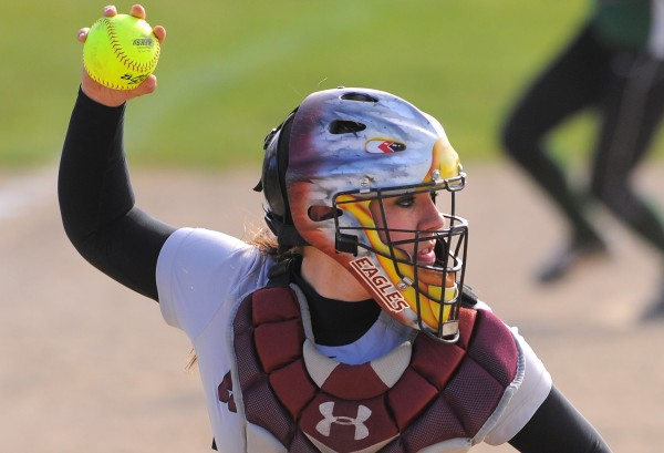 Ellsworth's catcher Cristin Wright throws the ball to first base during the game against Old Town in Ellsworth Thursday.