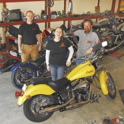 Mechanic Sean McGowan (from left), office manager Tricia Dunton, and owner J.D. Blaine in the work area at PanikSwitch Cycles. The shop, located 1.6 miles past the Sports Arena on Route 2 in Hermon, opened April 1, and will service anything and everything.