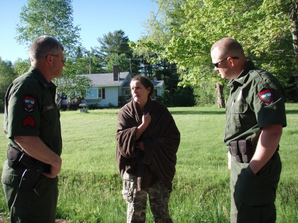 Janet Rier of Lubec talks to game wardens after she was found safely in Ellsworth Wednesday morning.