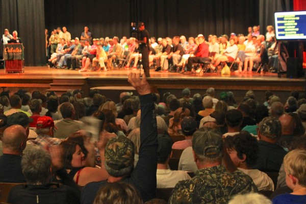 People fill the Greenville High School auditorium Saturday to hear the drawing for hunting permits in the 2013 moose lottery.