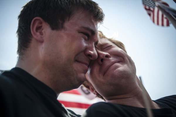 Michael Knaapen (left) and his husband, John Becker, both of Wisconsin, react to the 5-4 ruling striking down as unconstitutional the Defense of Marriage Act at the U.S. Supreme Court in Washington June 26, 2013.
