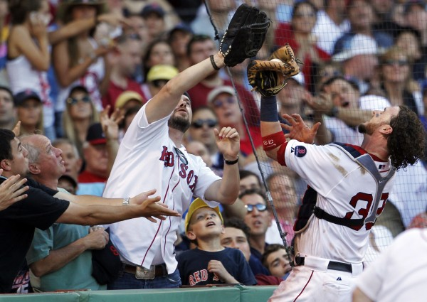 Boston Red Sox catcher Jarrod Saltalamacchia beats fans to the ball to catch a foul popup by Toronto Blue Jays' Rajai Davis during the eighth inning Saturday at Fenway Park in Boston.