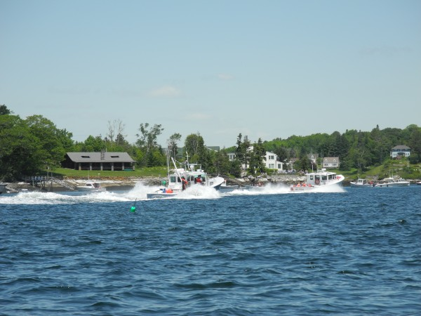 Boats go head to head Saturday in Boothbay Harbor during the first race day of the 2013 Maine Lobster Boat Races.