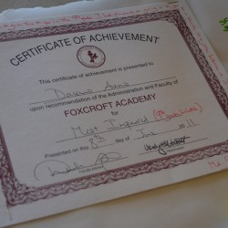 A certificate of achievement for Dacano Arno is stapled to a memorial banner at Foxcroft Academy in Dover-Foxcroft on June 4, 2013.