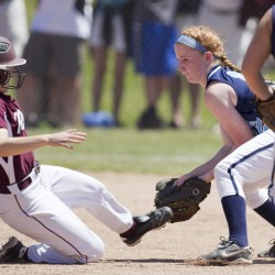 Oceanside shortstop Molly Mellor prepares to tag out Greely's Hannah Butland on a steal attempt at second base in the Class B softball state championship in Standish.