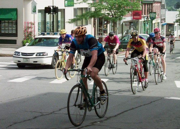 Cyclists race up Belfast's Main Street as part of the annual Maine Bike Rally in July 2005.