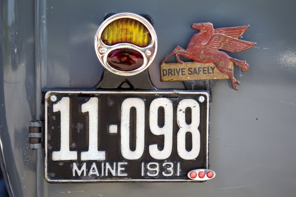 A Mobil pegasus decorates the back end of Cyde Ricker's 1931 Model A Ford panel truck, Sunday, June 2, 2013, in Falmouth, Maine.