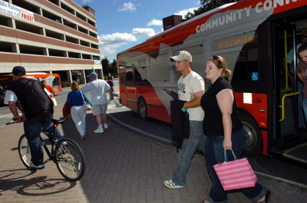 Commuters, including Dawn Hans (right) and her fiance Andrew Fox, both of Bangor, disembark a BAT bus at Pickering Square in Bangor in this 2008 file photo.