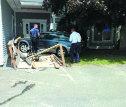 Brunswick police Sgt. Russ Wrede said Carol Frucht, 85, of Topsham, was driving her husband David Frucht, 90, to Midcoast Eye Associates when she hit the gas pedal instead of the brake, slamming the car into the side of the business.