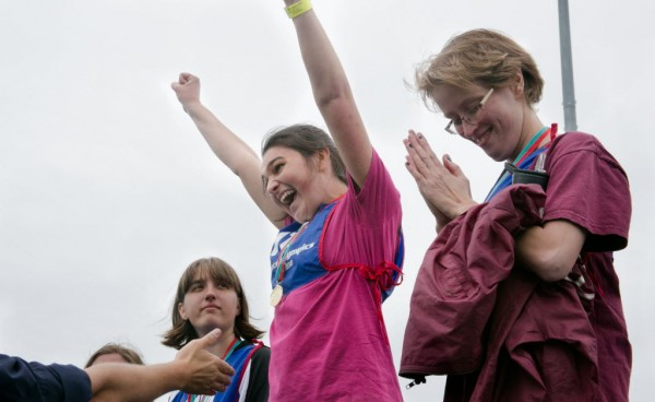 Moriah Costello (center) of Corrina celebrates at the podium after winning a gold medal in the 400 meter run finals at the Special Olympics Maine State Summer Games at the University of Maine in Orono on Friday, June 6, 2013.