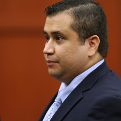 George Zimmerman leaves the courtroom during a recess in his trial at Seminole circuit court in Sanford, Fla., Friday.