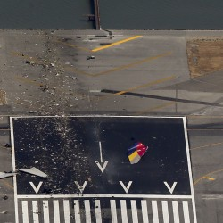 Debris from an Asiana Airlines Boeing 777 is seen on a runway after it crashed Saturday while landing at San Francisco International Airport in California.