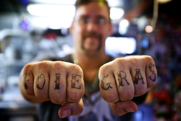 Chef Rocco Salvatore Talarico of Supperpie shows off his food-inspired tattoos while preparing a nine course, pop-up feast at a South Portland bagel shop. The humble bagel joint was transformed, for one night only, into foodie heaven.