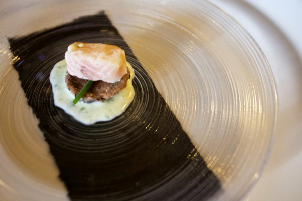 A first course of smoked trout, fermented black bean and chive is served at a pop-up dinner in South Portland.