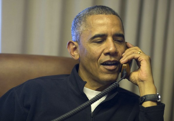 U.S. President Barack Obama speaks on the phone from while aboard Air Force One on a week-long trip to Senegal, South Africa and Tanzania, in this handout photograph taken and released on June 26, 2013. The president phoned same-sex marriage plaintiffs on their cell phones to congratulate them as they stood outside the Supreme Court, following the Court's decision that made married gay men and women eligible for federal benefits.