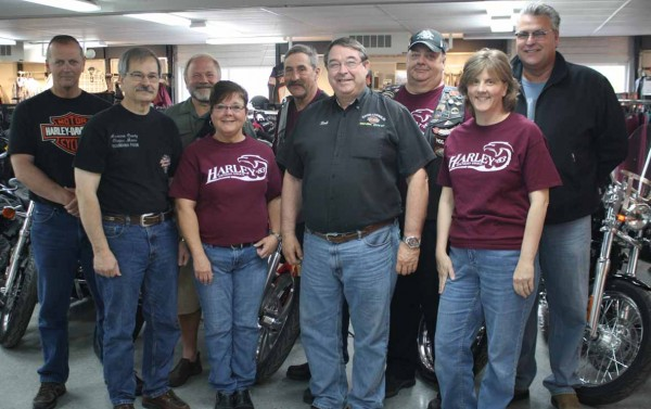 The founding officers of the Aroostook County chapter of the Harley Owners' Group recently met with the current officers 20 years after formation of the local group. Present for the meeting were, from left, front row, founding director Phil Bosse, current director Karla St. Peter, sponsoring dealer Bob Plourde, and current treasurer Tracy McCrossin; back row, founding treasurer Doug Conroy; founding secretary Steve Mazerolle, current secretary Stan Targonski, current assistant director Greg Belanger and founding assistant director Doug Morrell.