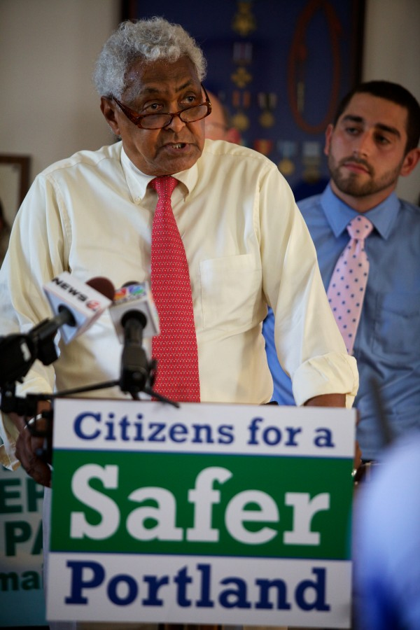 Bob Talbot (left) of the American Civil Liberties Union of Maine said the state's marijuana laws unfairly target African-Americans at a press conference Monday in Portland.