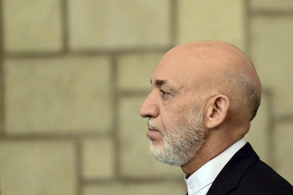 Afghan President Hamid Karzai looks on during a joint news conference with British Prime Minister David Cameron at the Presidential Palace in Kabul June 29, 2013.