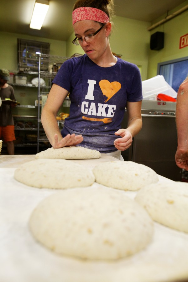Melanie Roy kneads dough at Scratch Baking Co. in South Portland on Wednesday morning.