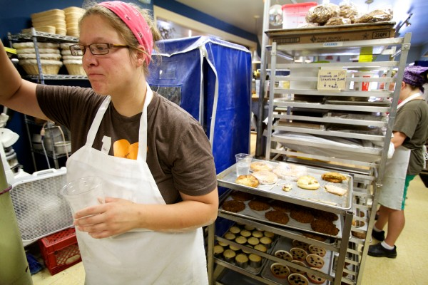 Emily Pappas catches her breath with a cup of water in the heat at Scratch Baking Co. in South Portland on Wednesday.
