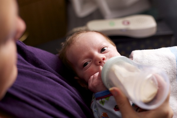 A one-month-old baby is fed in Eastern Maine Medical Center's Pediatric Intensive Care Unit.