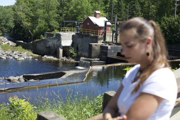 Jody Arno walks by the Sebec River where her son Dacano Arno drowned last month.