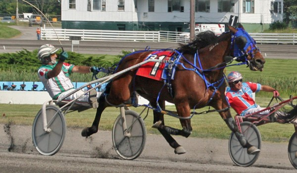 Billy &quotZeke&quot Parker guides Topgun Raider (front) to victory, Parker's 11,000th as a harness racing driver, Tuesday at Monticello (N.Y.) Raceway.