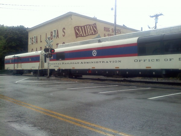 Federal Safety Administration train cars pass Saliba's on Front Street in Bangor Friday morning.