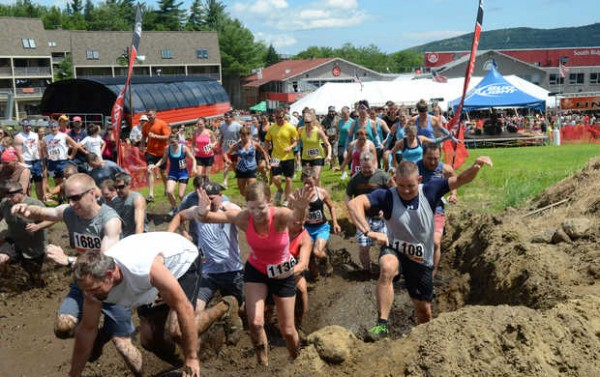 A heat of racers hits the first obstacle at the Tough Mountain Challenge at Sunday River in Newry on Saturday afternoon. The event drew a field of 3,000, up from 200 its first year in 2010. Heats of about 125 racers took off every 15 minutes from 9 a.m. to 3 p.m.