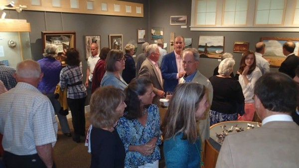 More than 150 people attended the members' reception for Out of the Woods: The Art and Nature of C. A. Porter Hopkins.