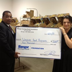 Darrell Gill, Bangor Savings Bank Forest Avenue Branch Manager, and Wayside Food Programs' Executive Director, Mary Zwolinski .