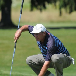 Tennis great Ivan Lendl lines up a putt on the first hole of Bangor Muni during the Greater Bangor Open on Thursday.