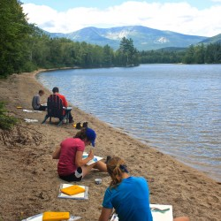 Katie Moody, 16, of Appleton (from closest); Emma Houston, 16, of Kingfield; John Devine, 17, of Gray; and Nate Skvorak, 17, of Windham, sit on a sandy beach on the south shore of Katahdin Lake on Aug. 10, 2013, painting watercolors of the view under the instruction of Maine artist Michael Vermette. The students are four of the 10 applicants chosen for the 2013 Maine Youth Wilderness Leadership Program organized by Friends of Baxter State Park.
