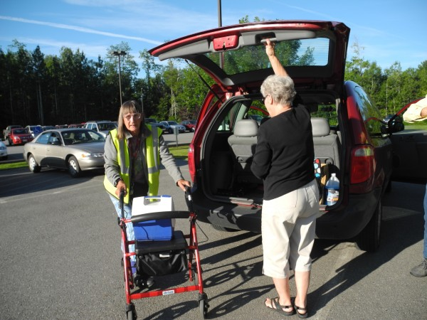 Mary Putansu (left) of Belfast heads to work this week at Little River Apparel after getting a ride by Waldo County Transportation driver Winnie Fowler. The state's August 1 switch to a new MaineCare transportation brokering, or dispatching, system has meant that many elderly, ill and impoverished Mainers have missed medical and other appointments in the last week.