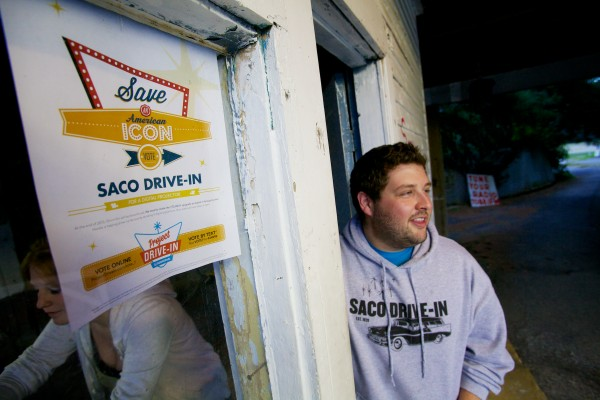 Ry Russell, 23, owner of the Saco Drive-In theater, gets the ticket booth ready with Corinne Ericson on Aug. 14, 2013.