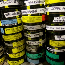 Rolls of films from the past sit stacked in the projectionist's booth at the Saco Drive-In theater Tuesday on Aug. 14, 2013.