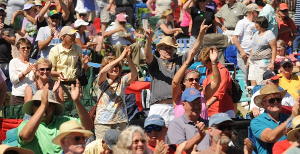 An appreciative crowd cheers as Blues singer Sister Monica parker plays a gospel set on the Bangor Daily News Railroad Stage on Sunday during the American Folk Festival on the Bangor Waterfront.