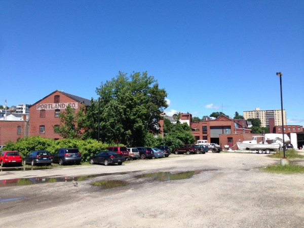 A group of developers have acquired The Portland Co. complex, a 10-acre site on Portland's eastern waterfront that includes several red brick buildings dating back to the late 19th century.