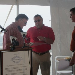Maine Gov. Paul LePage, center, talks with state Rep. Chuck Kruger, D-Thomaston, and Maine Marine Resources Commissioner Patrick Keliher at the Maine Lobster Festival in Rockland on Thursday.