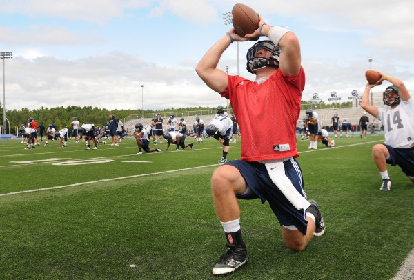 Marcus Wasilewski, UMaine's starting quarterback, warms up on Morse Field before the first practice of the season Monday.