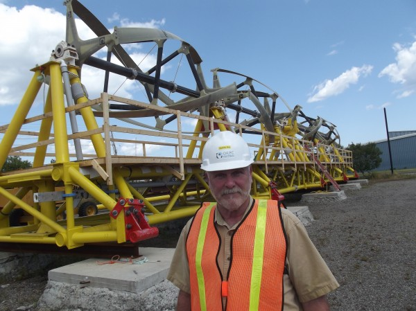 Bob Lewis, director of operations and planning and chief safety officer for Ocean Renewable Power Company at its office in Eastport, is shown with company's turbine generator at The Boat School facilities in Eastport.