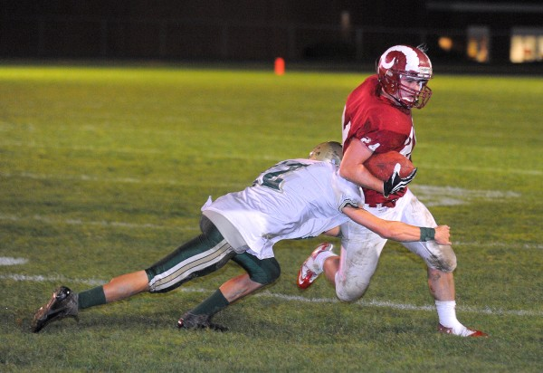 Bangor High School's Zeb Tuell (right) scrambles for more yardage as Oxford Hills High School's Ben Bowie tries to tackle him during the first quarter of the game in Bangor last year.