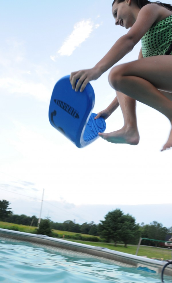 Olivia Johnson jumps into her family's backyard pool during a recent pool party.
