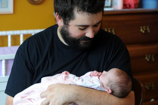 Matt Nichols holds his two-week-old baby, Ruby Ann, in his Bangor home. Nichols' wife, Heather, 29, passed away on August 8, 2013, at Eastern Maine Medical Center from necrotizing fasciitis, a flesh eating bacteria, that she contracted from an episiotomy during childbirth.