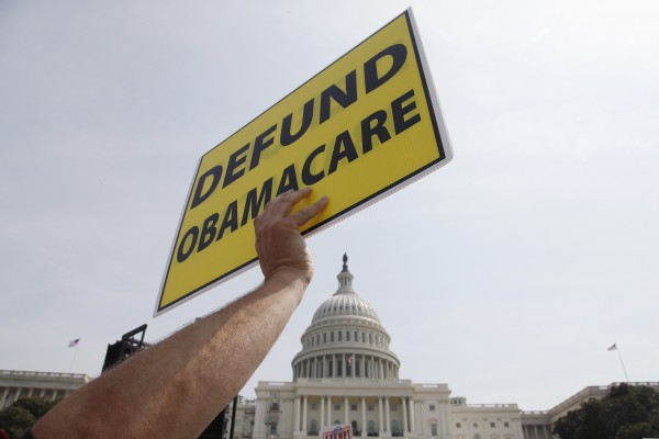A man holds a sign at the Tea Party Patriots Exempt America from Obamacare rally on the west lawn of the U.S. Capitol in Washington, on Sept. 10.