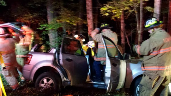 Rescue crews work to free a Lebanon man from his car after an accident on the Prospect Hill Road on Tuesday night.