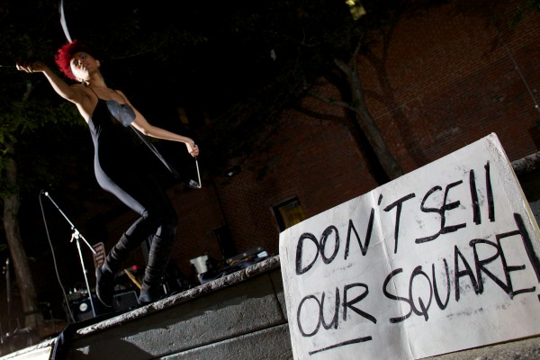 Burlesque performer Aquarius Funkk dances in Portland's Congress Square Park Friday night protesting the possible sale of the park to a private developer.